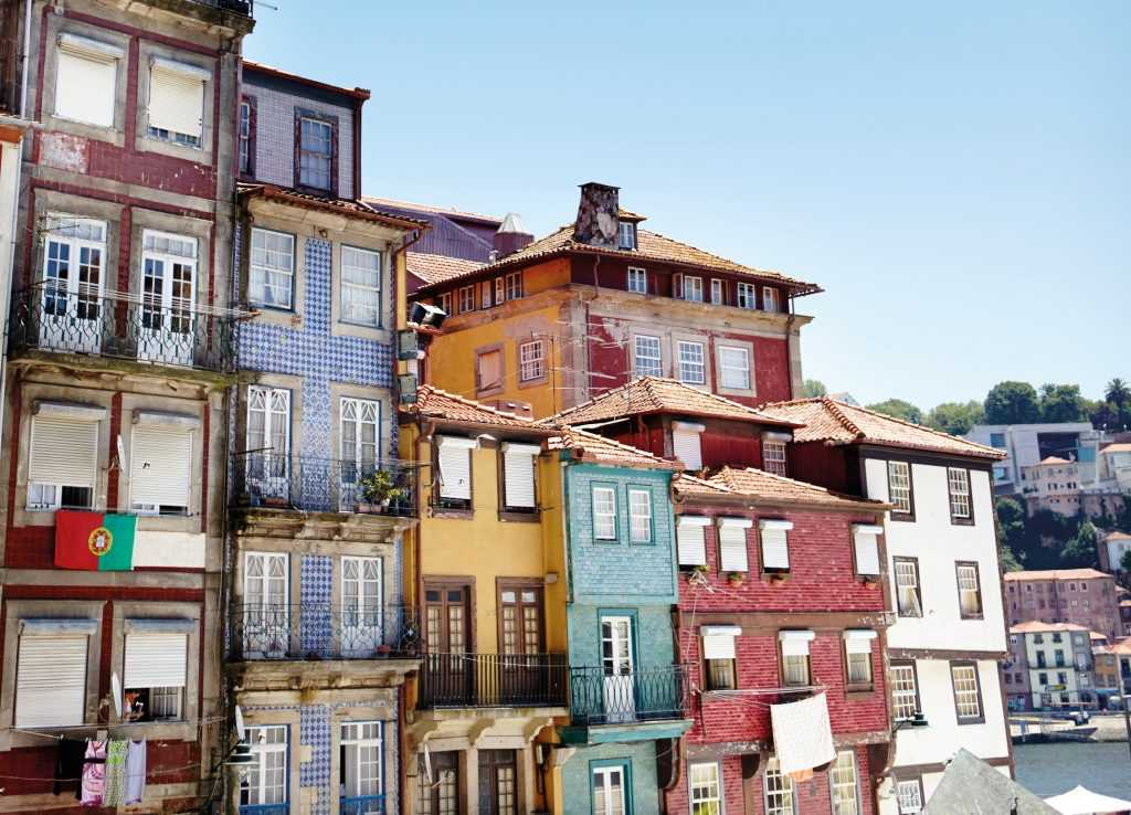 Colourful terraced houses line historic Ribeira Square on the banks of the Rio Douro in Porto.
