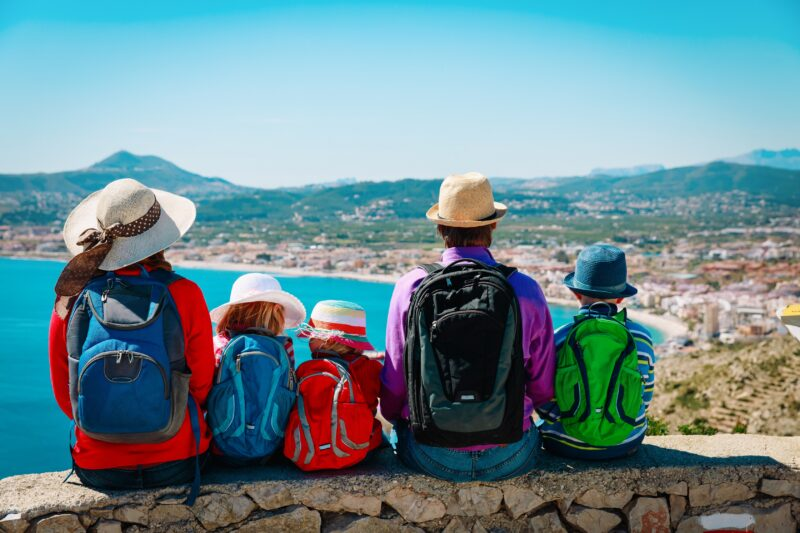 Family,With,Kids,Travel,In,Europe,,Spain,,Looking,At,Scenic